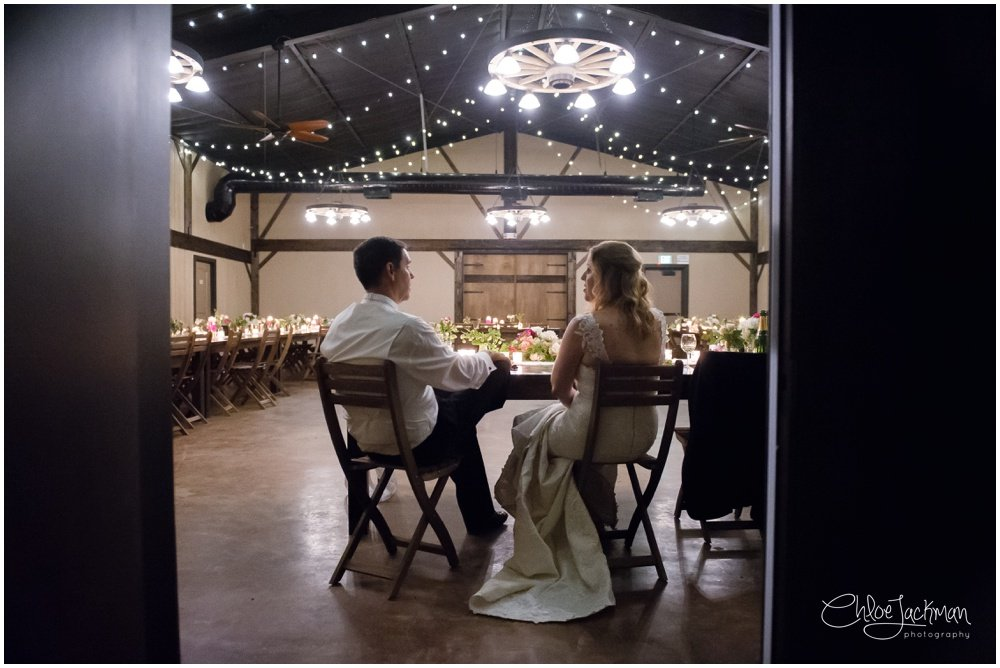 bride and groom sitting down at highlands estate wedding
