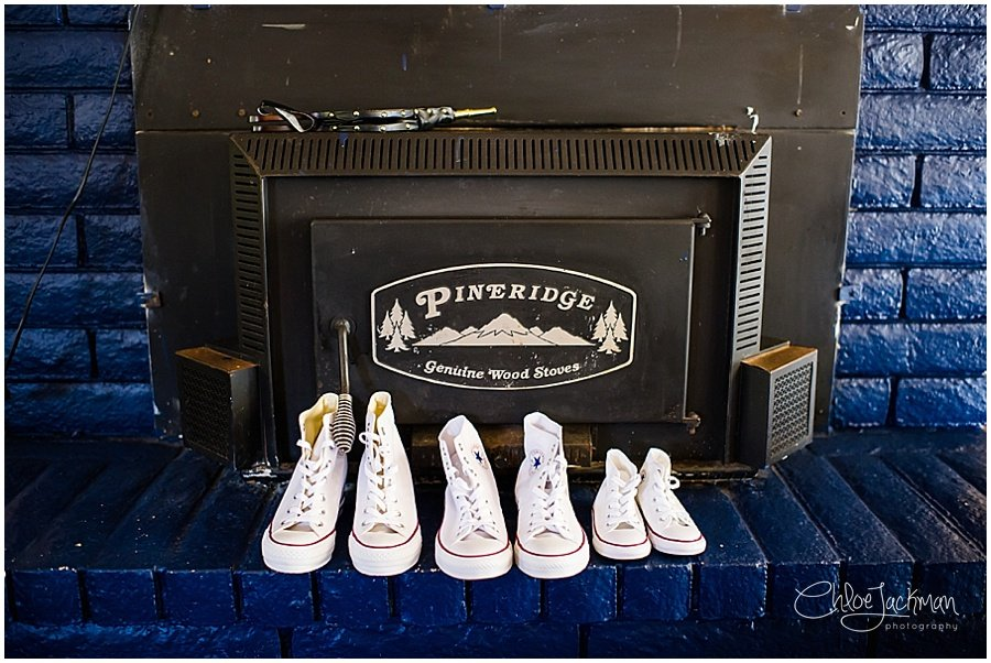 chuck taylor shoes in front of fireplace