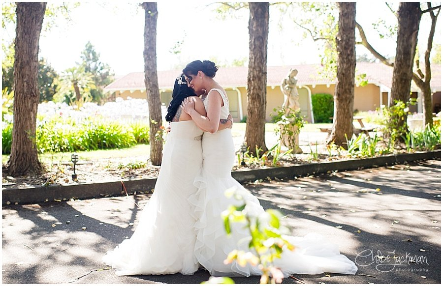 same sex wedding brides first look embrace