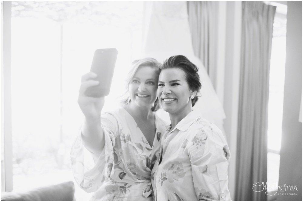 bridesmaids taking selfies