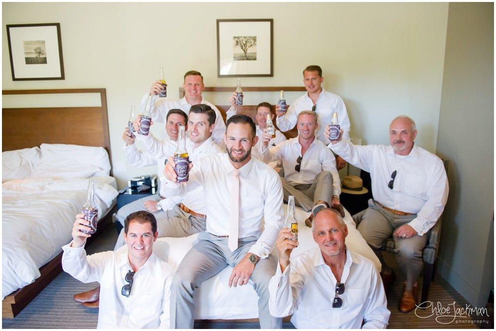 groomsmen cheersing with beer