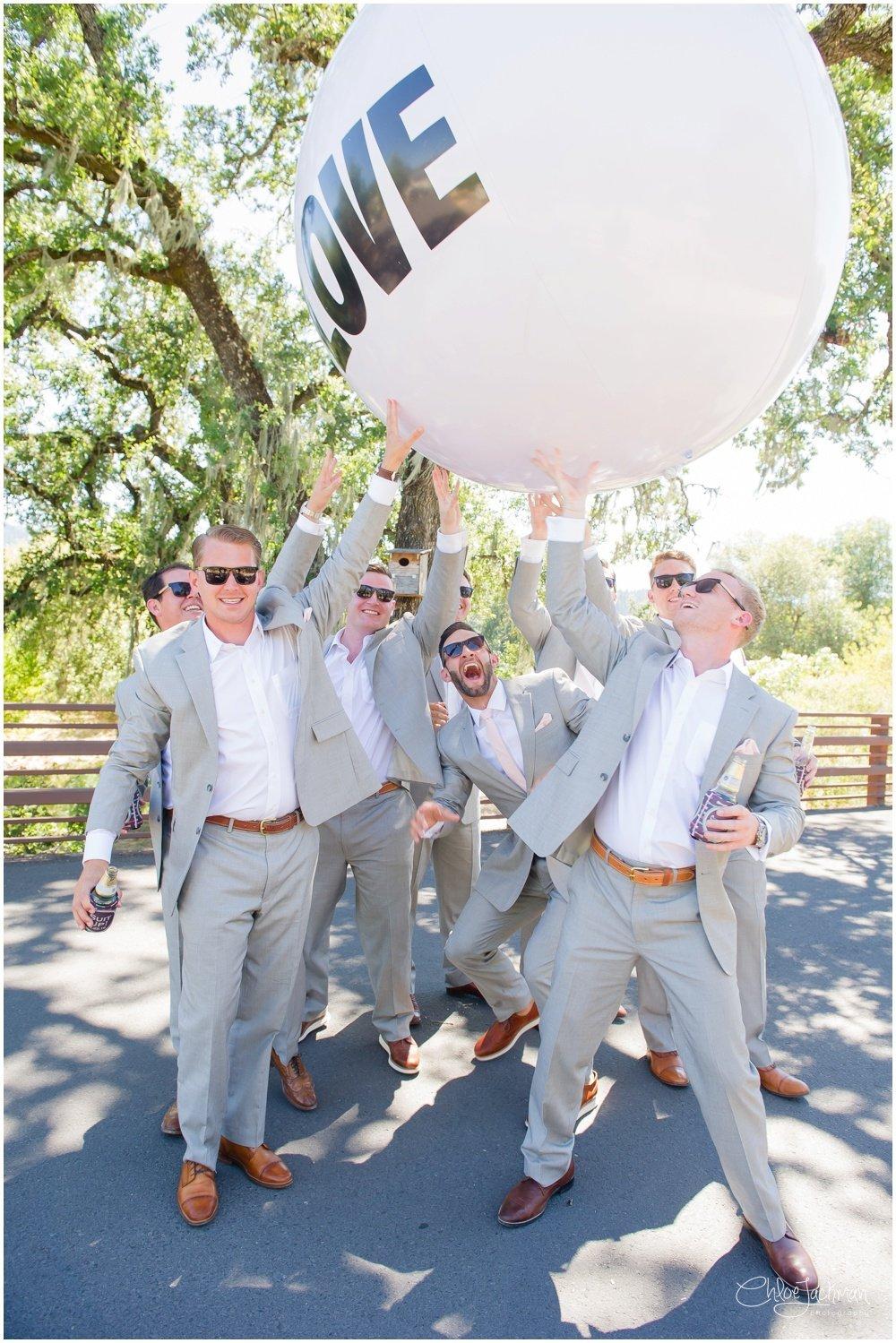 groom and groomsmen with giant balloon
