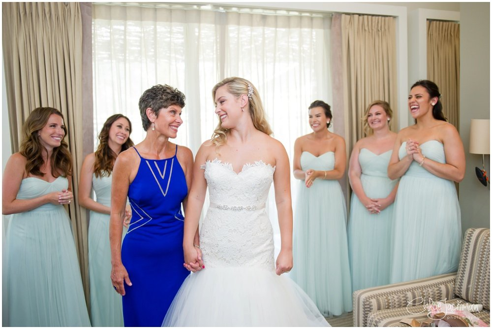 bride looking at mother wearing Tara Keely wedding dress