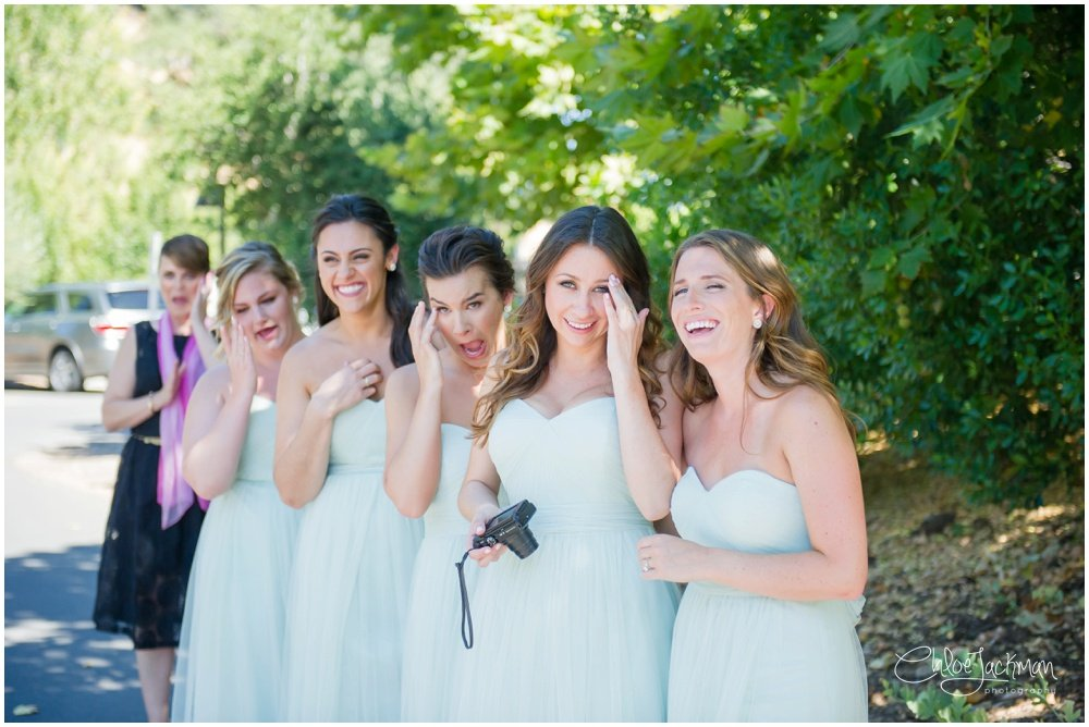 bridesmaids smiling wearing mint green dresses
