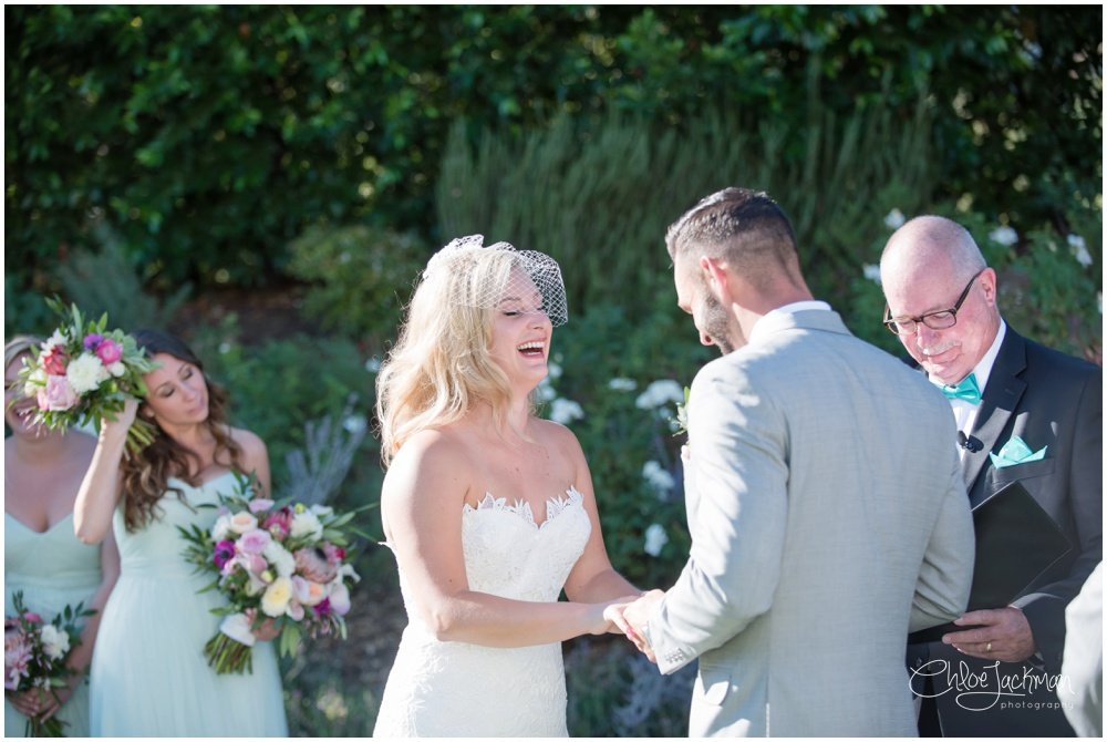 bride wearing tara keely wedding dress and groom smiling at the altar solage calistoga wedding