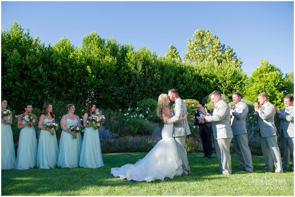 Bride and groom first kiss at their solage calistoga wedding