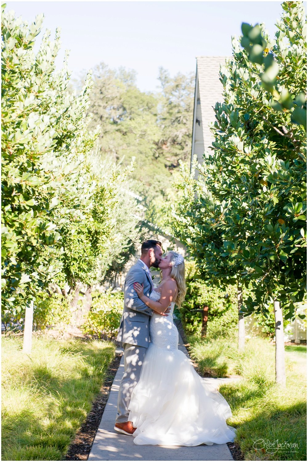 bride and groom kissing at their solage calistoga wedding
