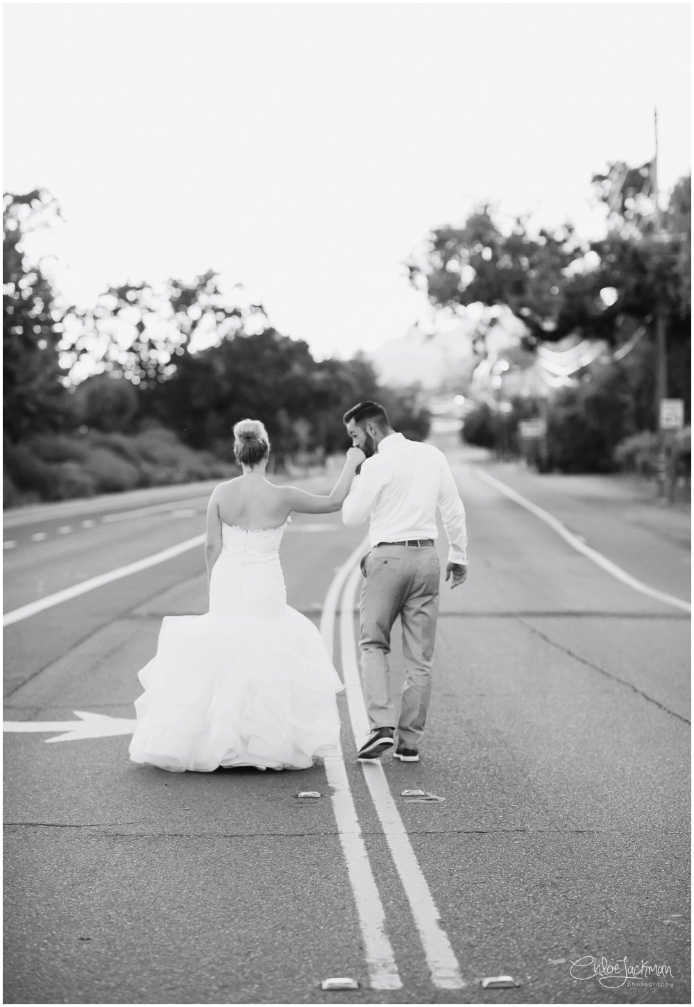 bride and groom walking down a road