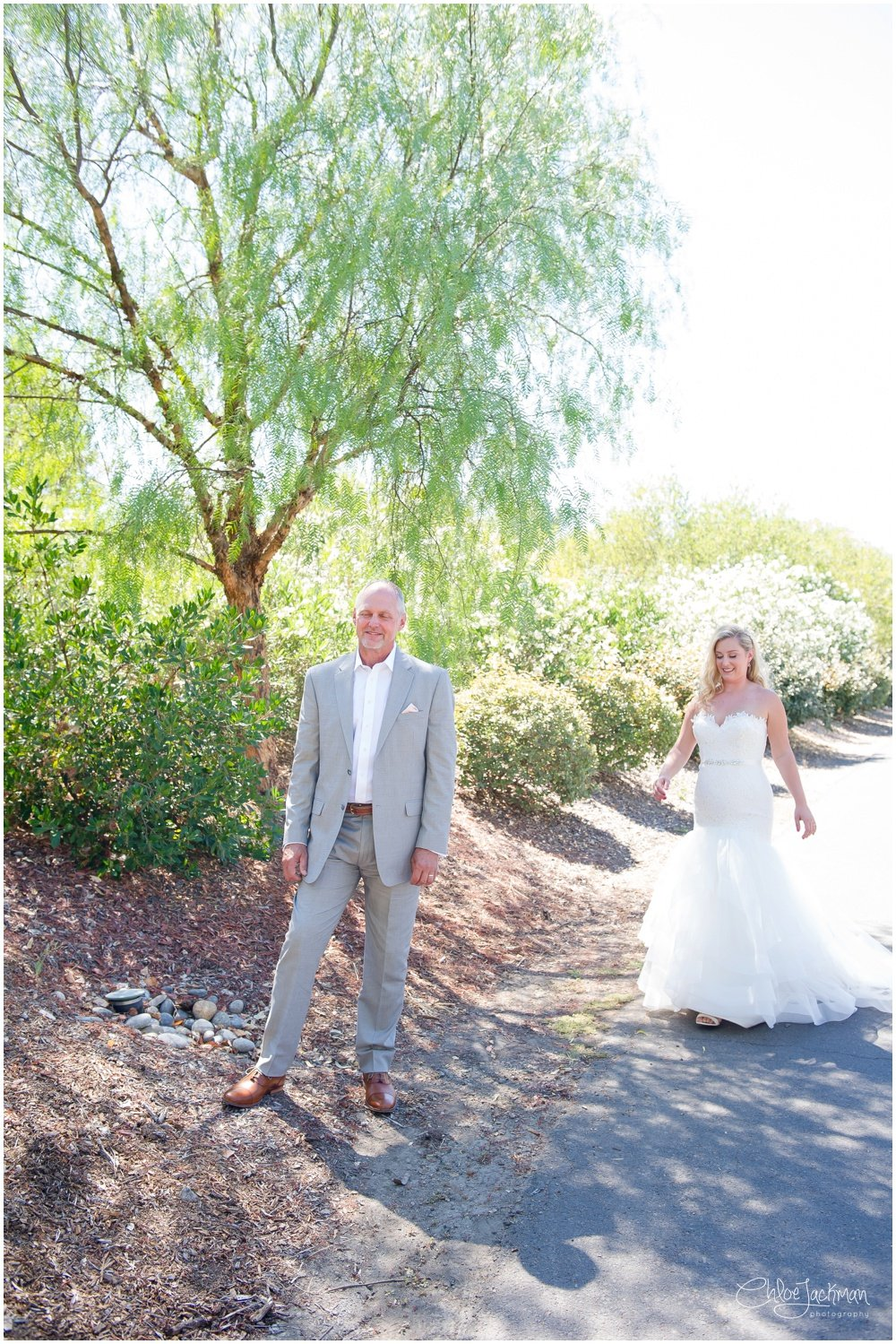 Bride wearing Tara Keely wedding dress and father of the bride first look