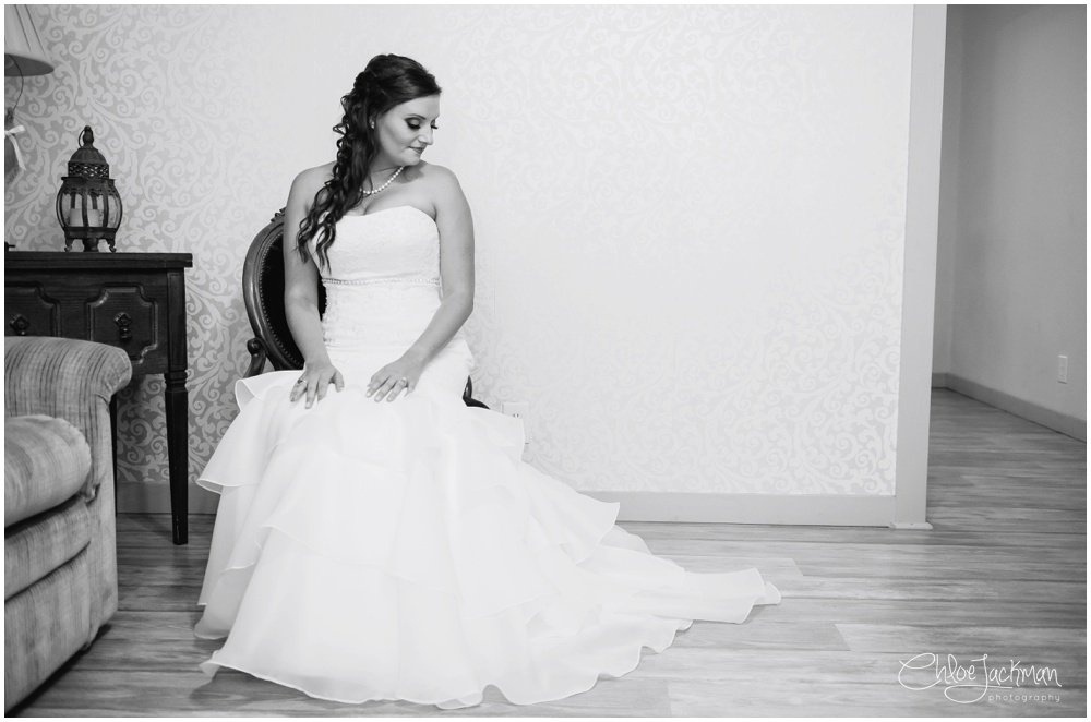 bride sitting in wedding dress