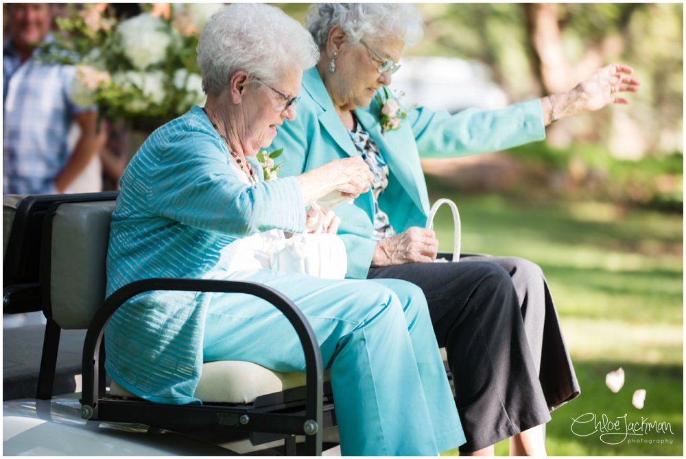 grandmothers on golf cart rolling down the aisle