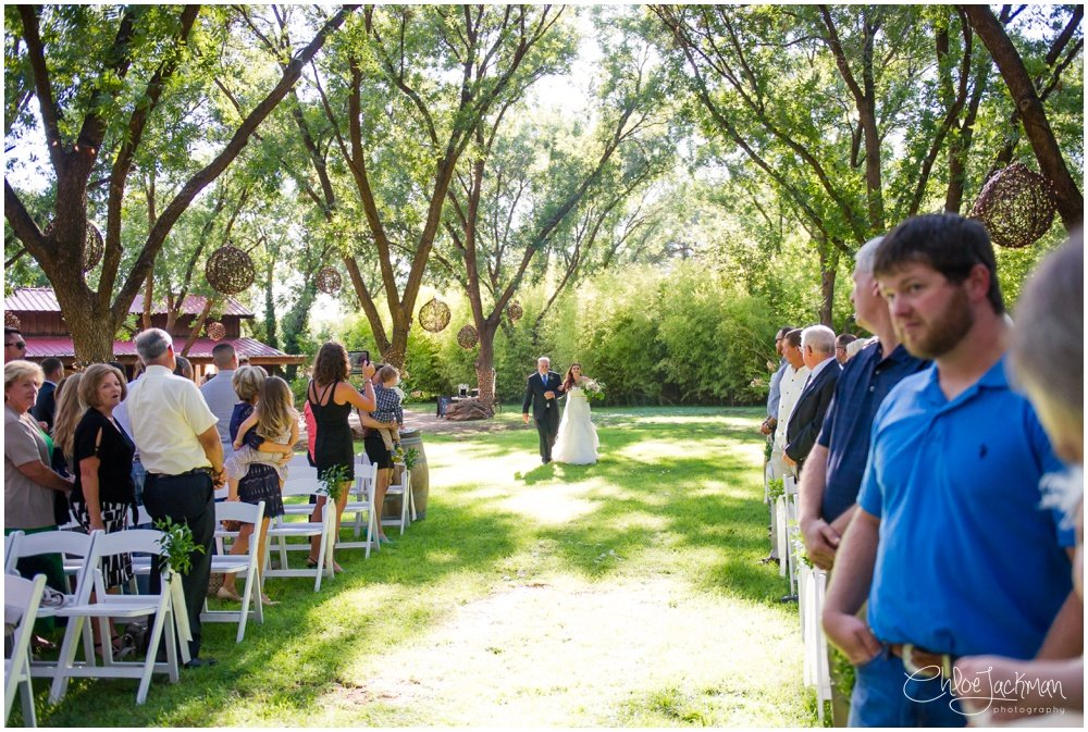 bride and father of the bride walking own the aisle at fulford barn wedding in texas