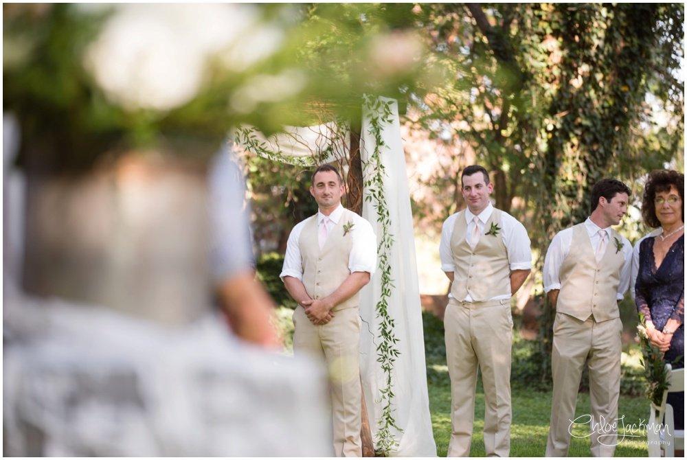 groom at the altar at fulford barn wedding in texas