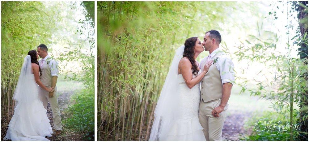 bride and groom kissing at fulford barn wedding in texas