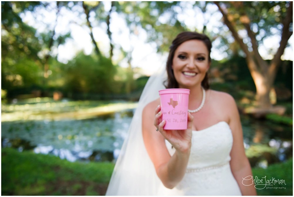 bride holding wedding cups
