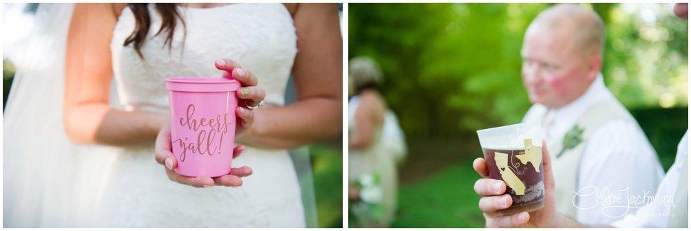 bride holding wedding cups