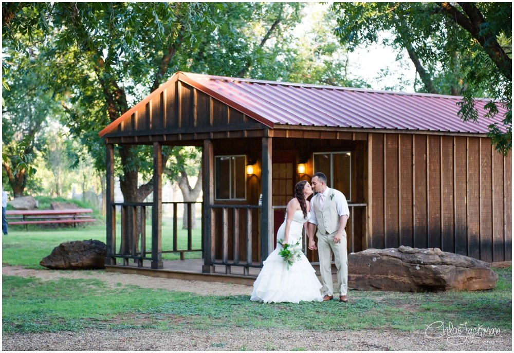 bride and groom kissing at at fulford barn wedding in texas