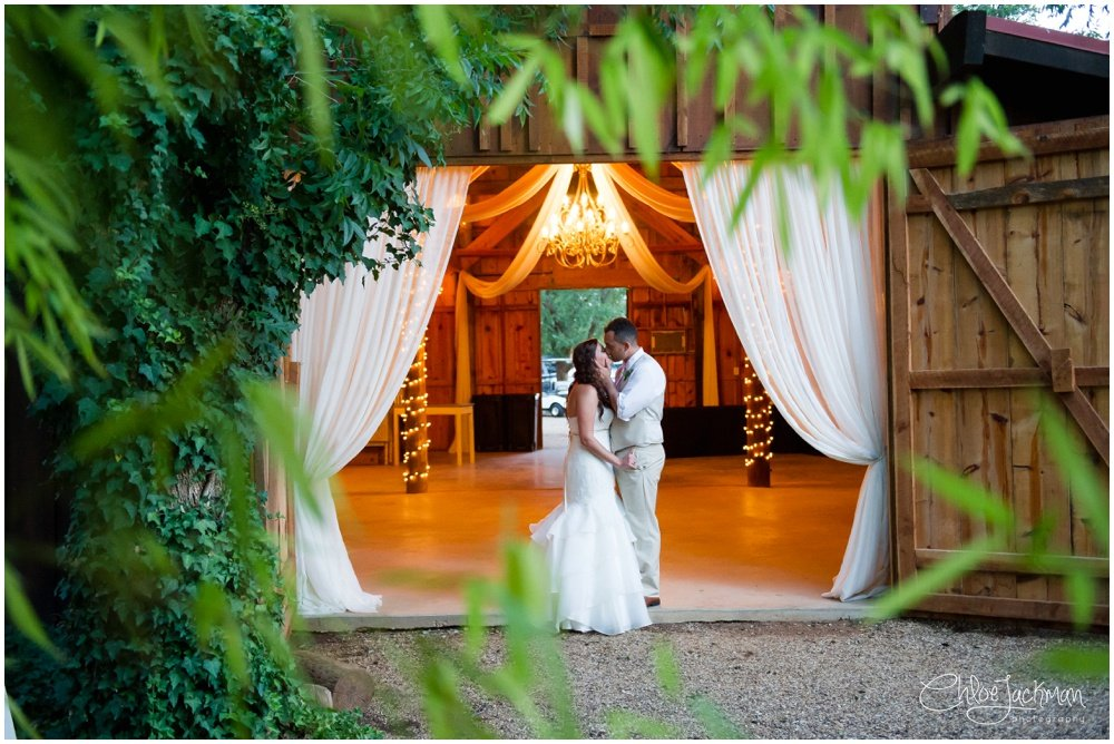 bride and groom embracing outside at bride and father dance at fulford barn wedding in texas