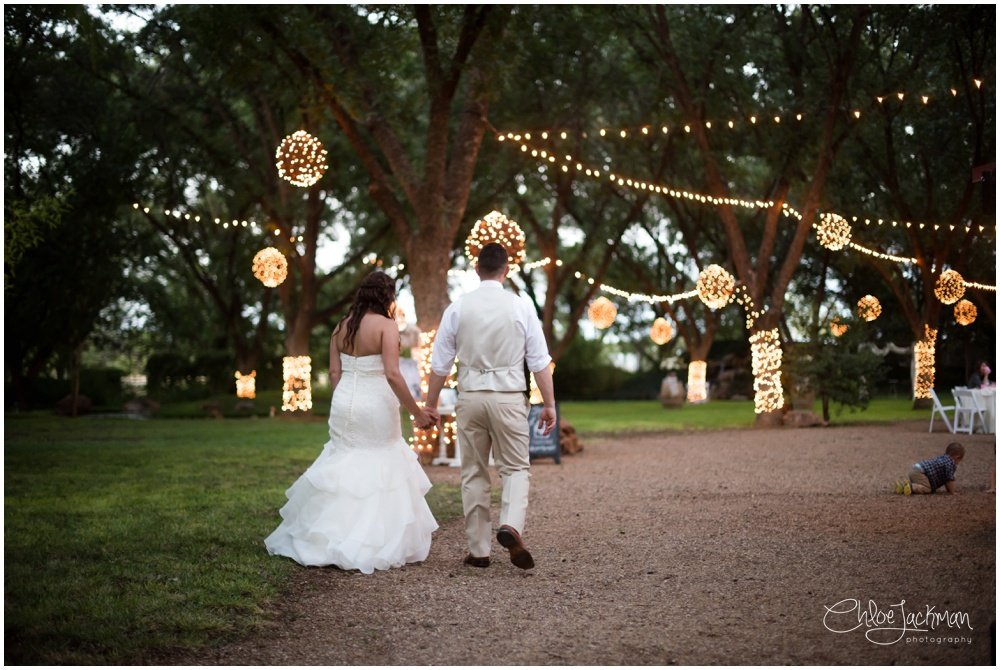 bride and groom holding hands outside at bride and father dance at fulford barn wedding in texas