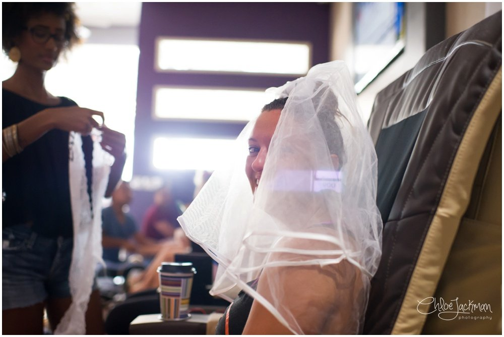 bride in veil getting a manicure