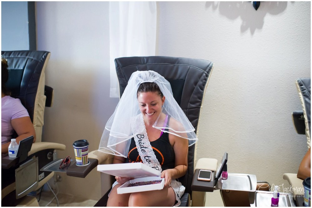 bride in veil getting manicure