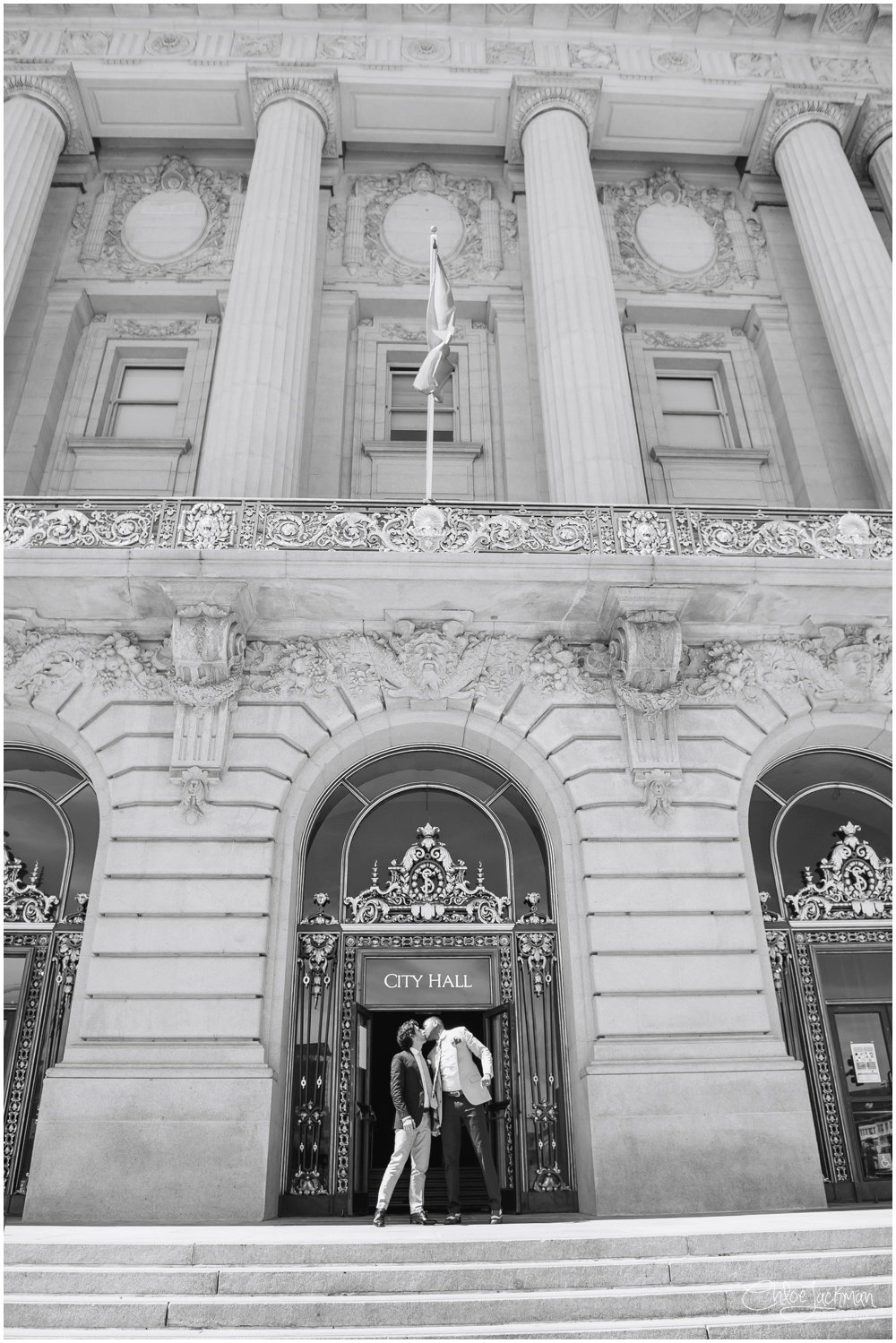 same sex couple kissing outside of san francisco city hall