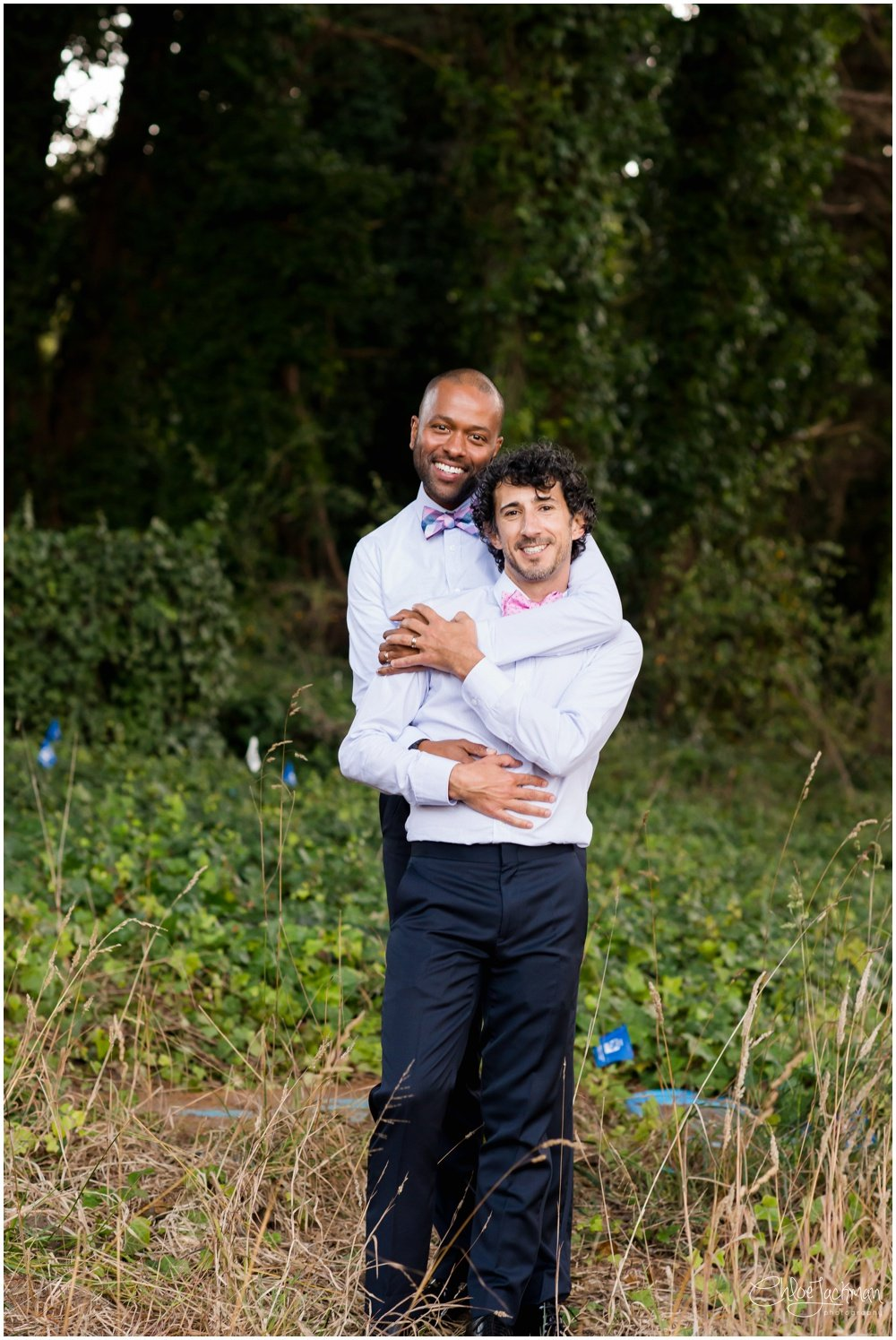 grooms embracing in the presidio san francisco