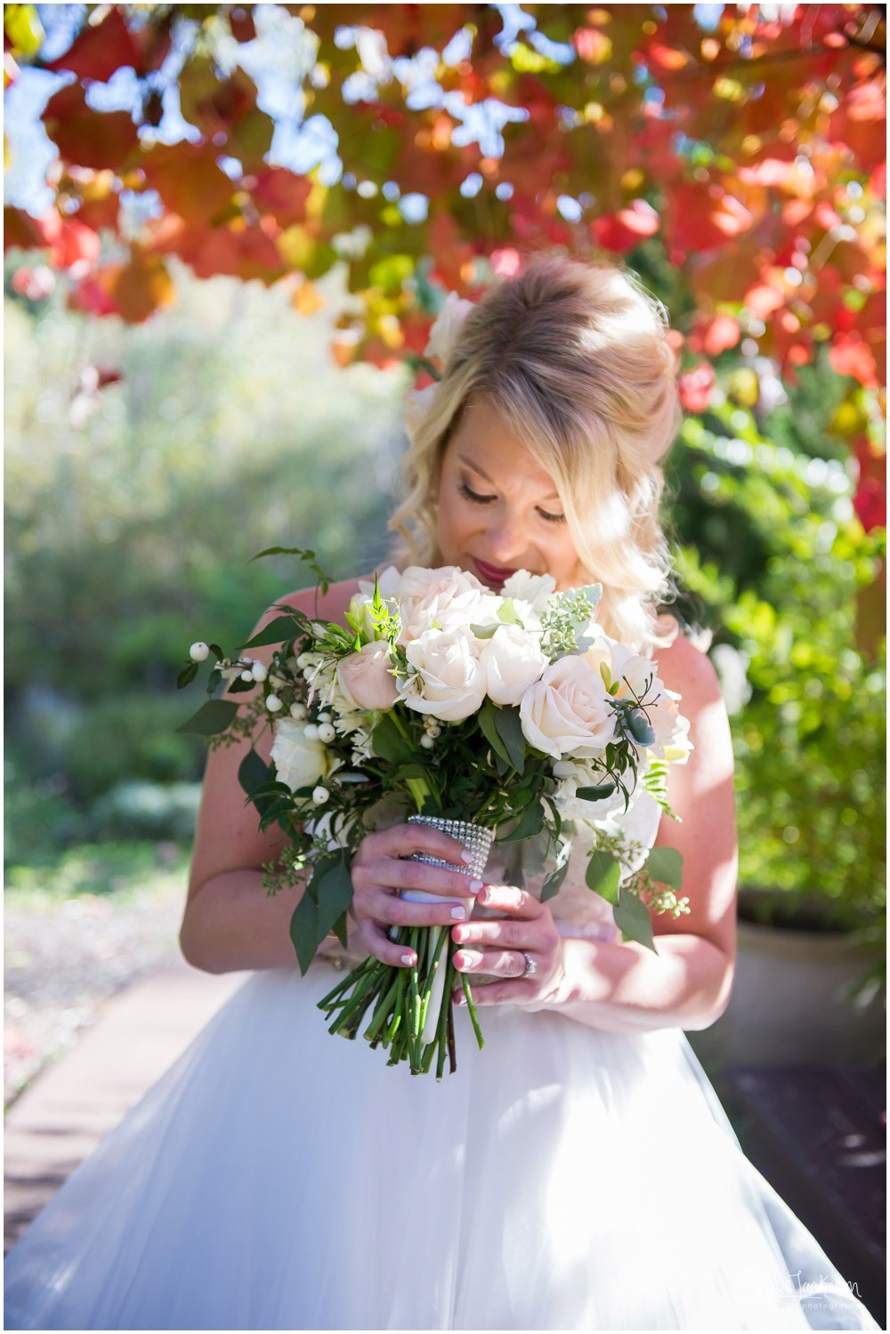 bride holding wedding bouquet by flaxx floral design