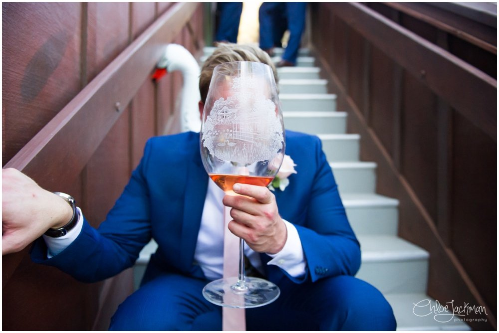 groomsmen holding giant wine glass full of beer