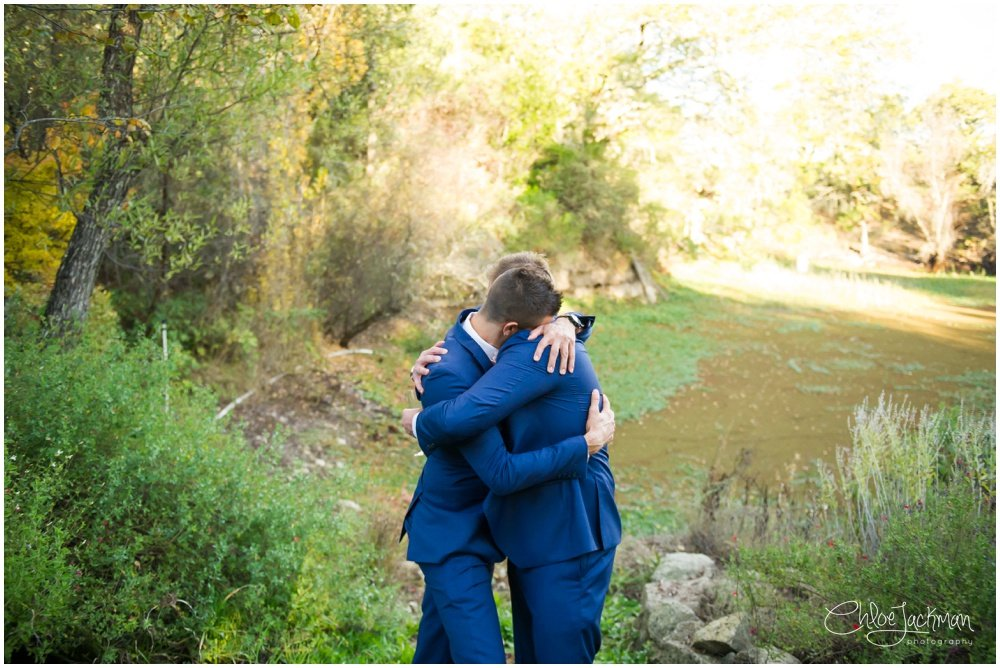 groom and groomsmen embracing