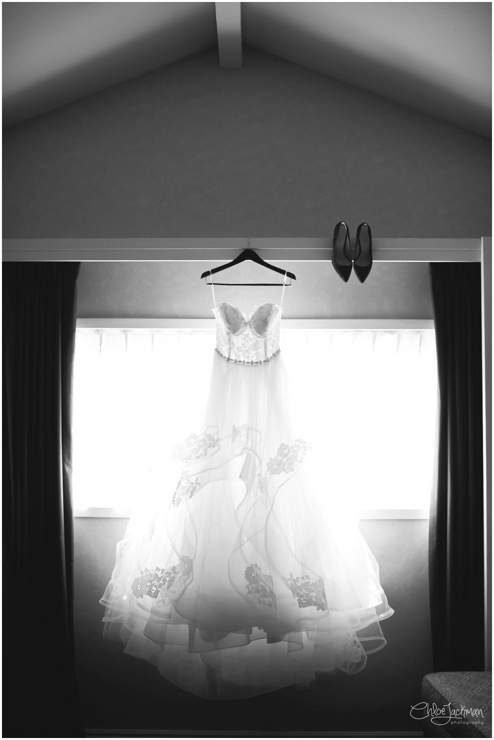 Hayley Paige wedding dress hanging in window