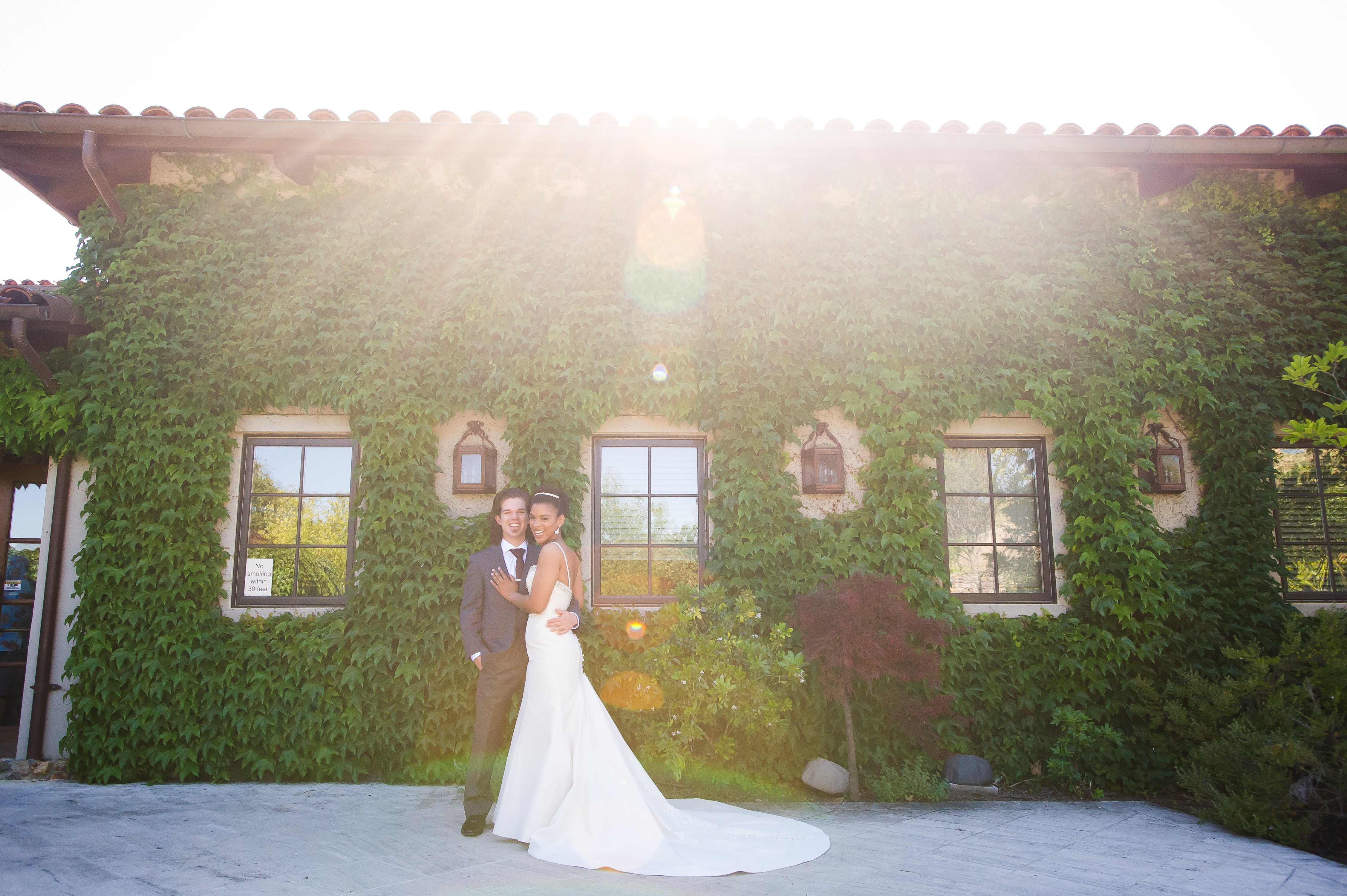 Bride and groom embracing outside at clos la chance winery wedding
