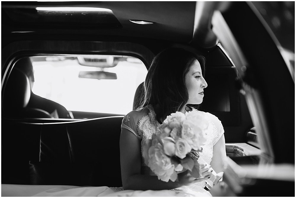 Bride sits in limo smiling before Claremont Hotel Wedding by chloe jackman photography