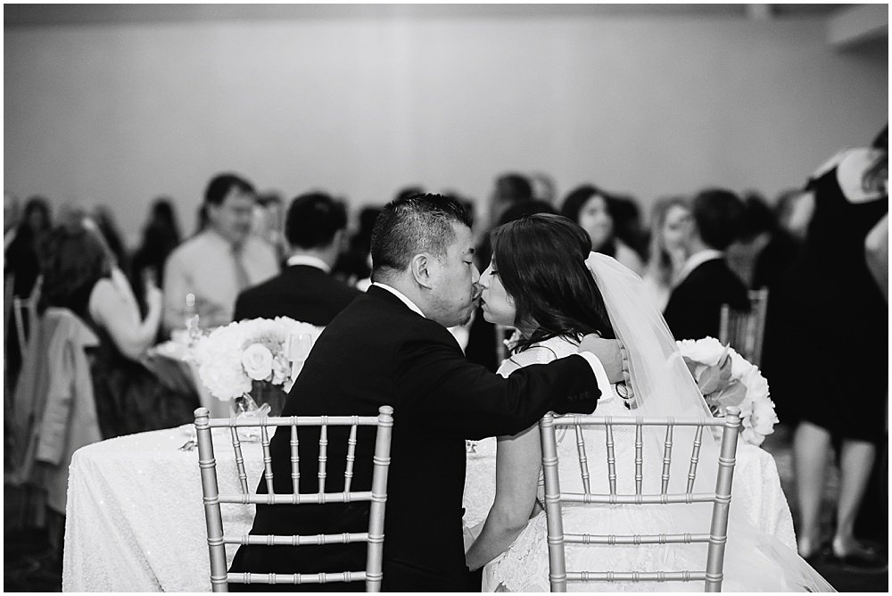 Bride and groom kiss at reception at claremont hotel wedding by chloe jackman photography
