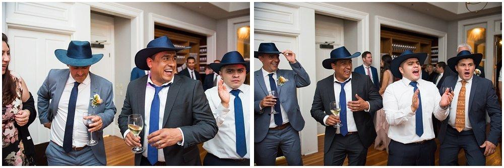 Dancing dudes in cowboy hats at General's Daughter wedding