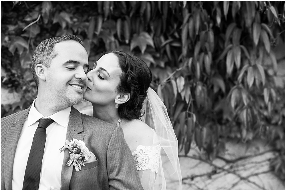 Bride kisses grooms cheek at General's Daughter Wedding by Chloe Jackman Photography