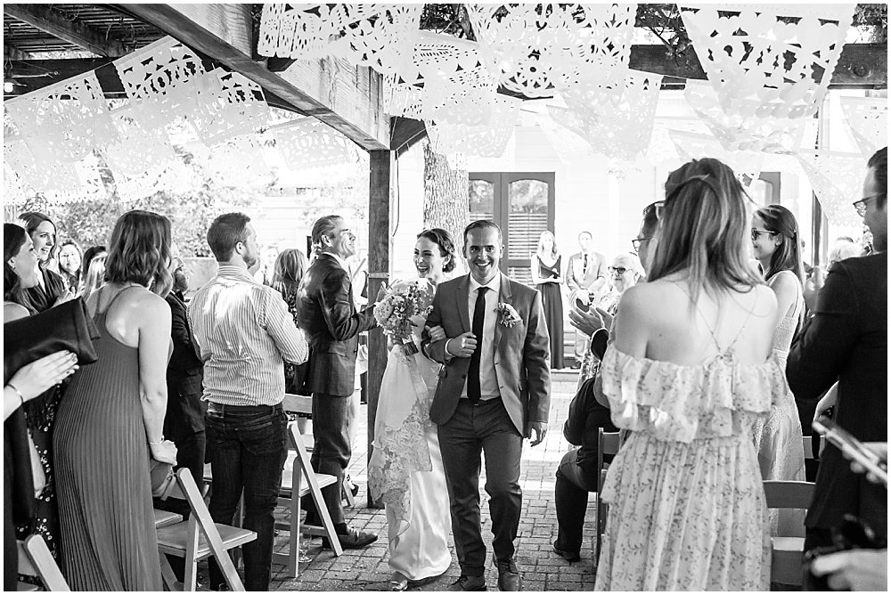 Happy couple walking down the aisle at General's Daughter Wedding in Sonoma by Chloe Jackman Photography