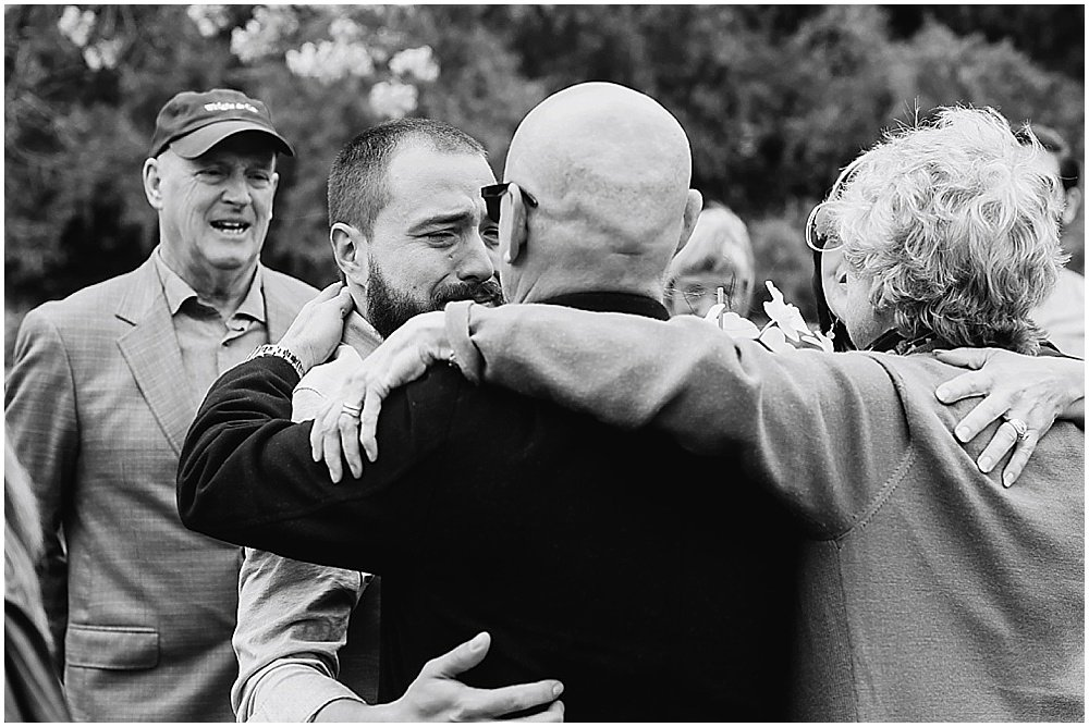 Groom hugs and happy cries with guests at golden gate park wedding by chloe jackman photography