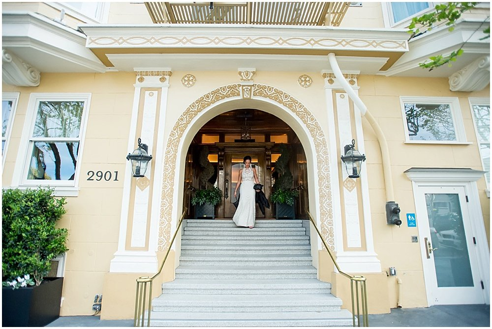 Bride walks down steps on the way to the commissary wedding in san francisco by chloe jackman photography