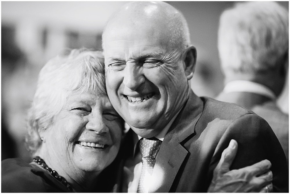 Father and mother of the bride embrace at the commissary wedding in san francisco by chloe jackman photography