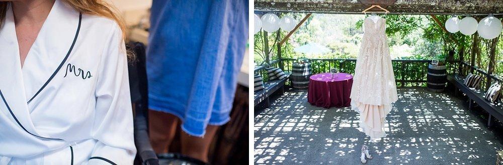 Brides dress hanging up at hans fahden winery wedding