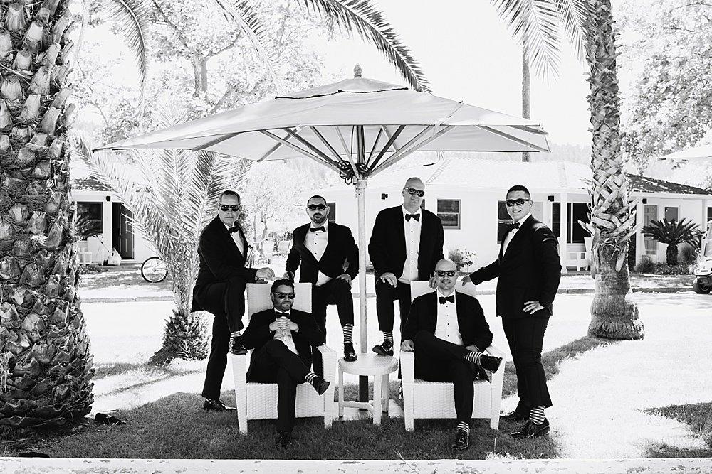 groomsmen outside strike a pose before hans fahden winery wedding by chloe jackman photography