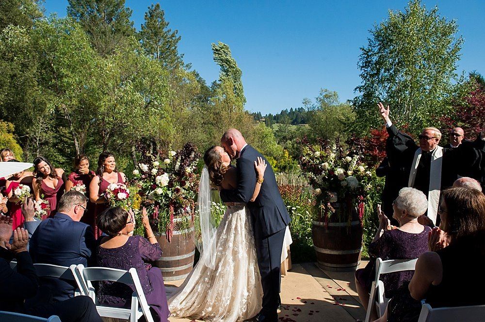 Bride and groom kiss at hans fahden winery wedding