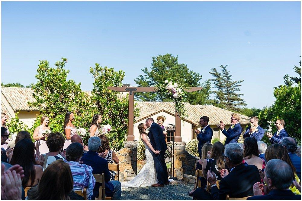 Bride and groom kiss at midsummer sebastopol wedding by chloe jackman photography