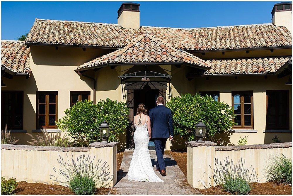 bride and groom walk to reception at midsummer sebastopol wedding