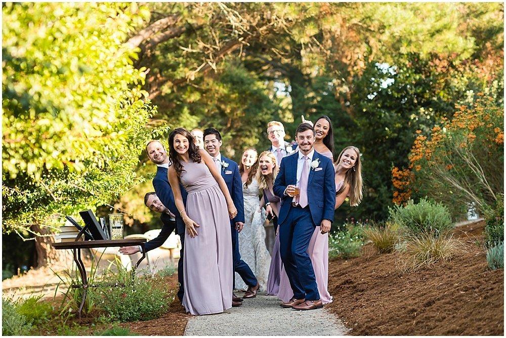 Wedding party group photo fun at midsummer sebastopol wedding by chloe jackman photography