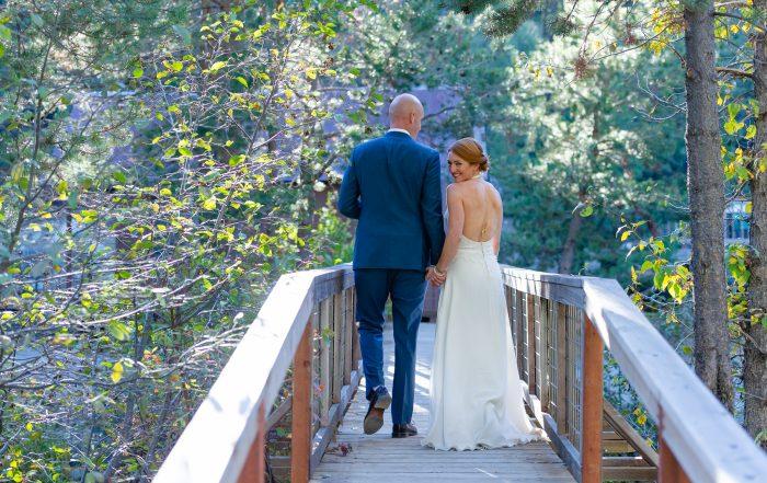 Bride looking over shoulder at gray eagle wedding by chloe jackman photography