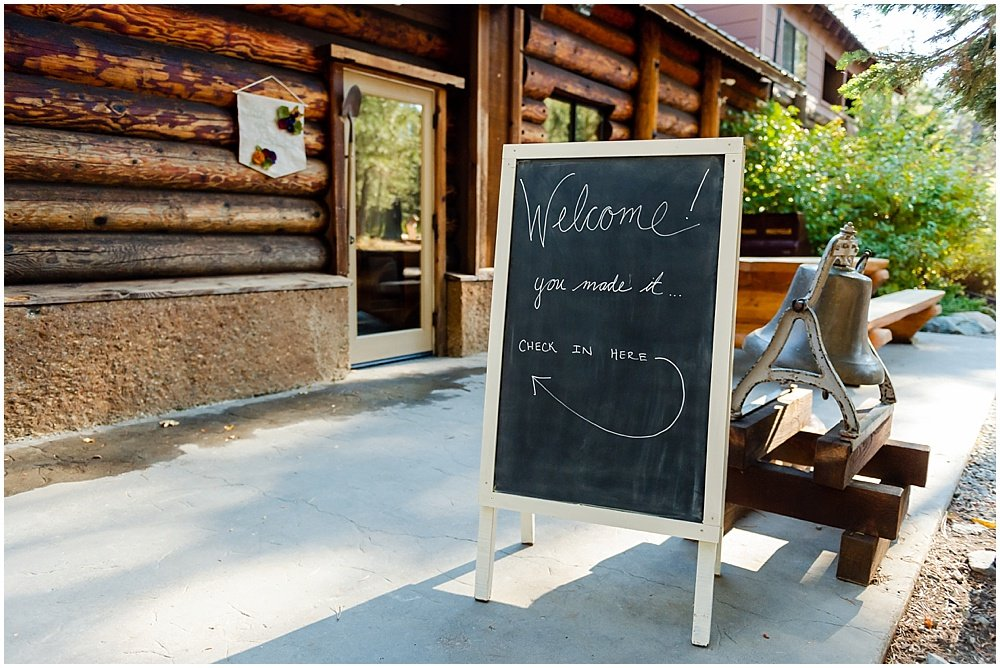 welcome sign at gray eagle lodge wedding