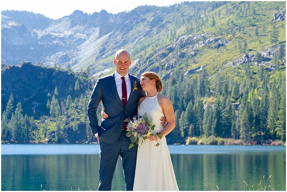 Bride looks adoringly at groom at gray eagle lodge wedding by chloe jackman photography