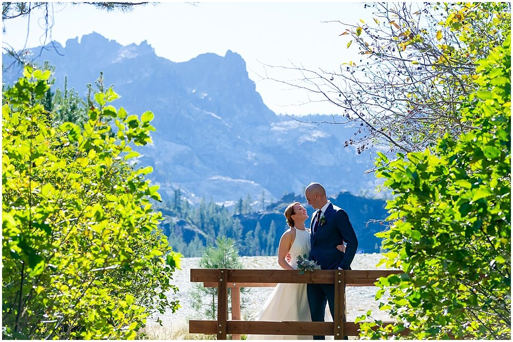 bride and groom on bridge at gray eagle lodge wedding by chloe jackman photography